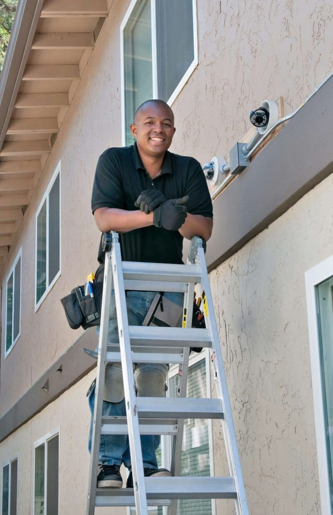 man standing on a ladder